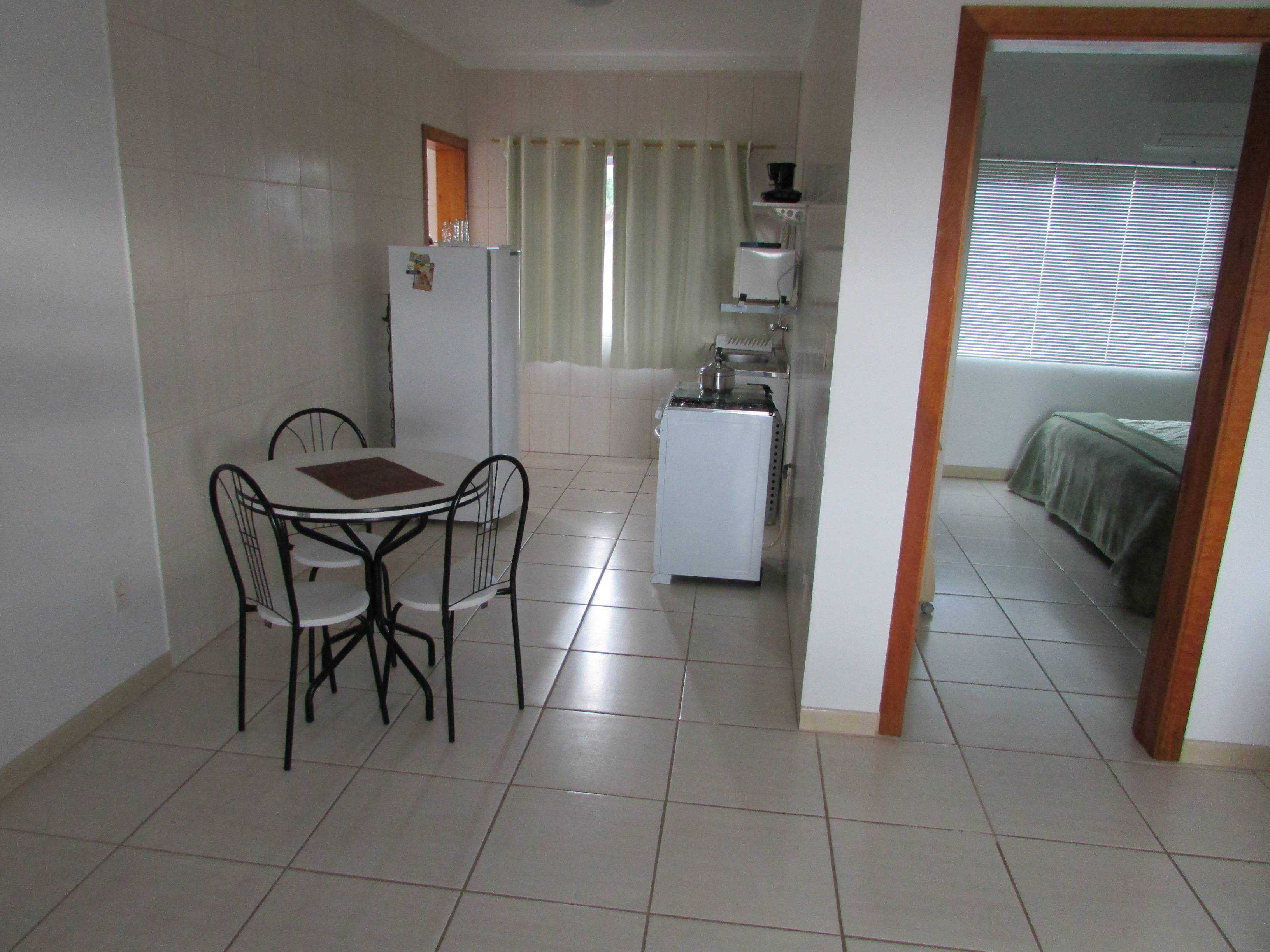 Kitchen with refrigerator, stove, microwave, coffee maker, toaster.